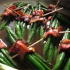 Green Bean Bundles Recipe - Steamed and then baked, these scrumptious green beans take on great flavor, because they are wrapped in bacon and bathed in a savory sauce. This recipe is best when you marinate the bundles overnight.