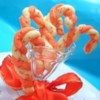 Candy Cane Cookies III Recipe - Red and white cookies shaped like candy canes. These are sprinkled with a mixture of sugar and crushed candy cane when they are hot out of the oven.