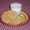 Peanut Butter Sandwich Cookies Recipe - A very rich, very addicting cookie.  Tastes best when cookies are stored in a tight container with several pieces of bread at the bottom.  You may need a little extra milk to get the filling to the right consistency.
