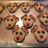 Reindeer Cookies Recipe - Shape sugar cookie dough into triangles and use pretzels for antlers and chocolate chips for eyes and nose for kid-pleasing reindeer cookies.