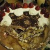 Tiramisu III Recipe - A Marsala wine custard is combined with whipped cream and mascarpone and layered with coffee and brandy soaked ladyfingers, then chilled before serving.