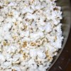Bacon Popcorn Recipe - This is a flavorful popcorn treat that makes your mouth water and disappears fast! If you toss the cooked popcorn in a paper bag, it helps to absorb any extra grease, and keeps kernels from falling to the floor. The leftovers make nice snacks for lunch boxes.