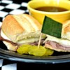 Easy French Dip Sandwiches Recipe - This sandwich made with sliced roast beef and provolone cheese is a crowd pleaser. The flavor is so rich, no one will know it only took 15 minutes to put together.
