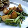 Oven Roasted Red Potatoes and Asparagus Recipe - This garlicky red potato and asparagus dish is easy and delicious. It can be served hot or cold.