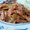 Cuban Ropa Vieja Recipe and Video - This is great shredded beef served on tortillas or over rice. Add sour cream, cheese, and fresh cilantro on the side.