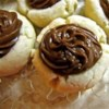 Brown-Eyed Susans I Recipe - A chocolate-topped thumbprint cookie topped with almond is your reward for following this simple holiday cookie recipe.