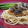 Chicken Breasts with Balsamic Vinegar and Garlic Recipe and Video - An aromatic, garlicky sauce of Balsamic vinegar and mushrooms graces this chicken dish.