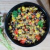 Black Bean and Couscous Salad Recipe and Video - Fluffy couscous is dotted with green onions, red pepper, fresh cilantro and black beans and boasts the Southwest tang of a lime-cumin vinaigrette.
