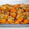 Pineapple Sweet Potatoes Recipe - Cubes of sweet potatoes and pineapple tidbits are baked with brown sugar, cinnamon, nutmeg and cloves in this Thanksgiving side dish.