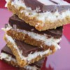 Mound Bars Recipe - Coconut bars on a graham crust topped with chocolate.