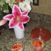 Jamaican Rum Punch Recipe - Three varieties of rum mixed with pineapple juice, lime juice, and orange juice in this fruity party punch.