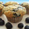 Health Nut Blueberry Muffins Recipe - Whole wheat flour, oats and wheat germ lend a hearty texture to these delicious muffins. An awesome healthy alternative to the usual blueberry muffin.