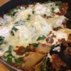 Skillet Spinach Lasagna Recipe - Sausage, lasagna noodles, and spinach are simmered with tomatoes and ricotta cheese in this quick and easy skillet lasagna.