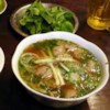 Vietnamese Beef Pho Recipe - Paper-thin slices of top round or sirloin are cooked along with rice noodles in individual serving bowls into which hot beef broth fragrant with lemon grass, ginger, and cinnamon is poured.