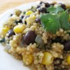 Quinoa and Black Beans Recipe and Video - Whether you're trying quinoa for the first time or just trying a new recipe for quinoa, this mixture of quinoa, black beans, corn, and spices will make this dish a new favorite.