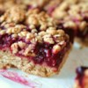 Delicious Raspberry Oatmeal Cookie Bars Recipe and Video - Seedless raspberry jam is sandwiched between buttery brown sugar-oatmeal cookie crusts.