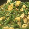 Spicy Green Beans and Pork, Asian Style Recipe - Fresh green beans are blistered in hot oil, then served in a spicy hot Asian-style ground pork sauce.