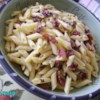 Bacon and Parmesan Penne Pasta Recipe - A simple but savory blend of penne pasta with bacon, Parmesan cheese, olive oil, and onion is perfect when you don't want a red sauce.