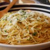 Spaghetti Aglio e Olio Recipe and Video - Spaghetti Aglio e Olio is a simple Italian dish of garlic, olive oil, parsley, and Parmigiano-Reggiano cheese tossed with cooked pasta.