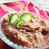 Refried Beans Without the Refry Recipe and Video - Flavorful refried beans seasoned with garlic, jalapeno, and cumin are simple to make when cooked in a slow cooker.