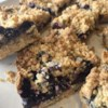 Blueberry Crumb Bars Recipe and Video - In these easy bar cookies, blueberries top a pastry crust and get sprinkled with a cinnamon crumble before baking. You can use any berries you like.