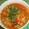 Vegan Mexican Stew Recipe - This vegan stew is absolutely excellent. A spicy hearty dish that is sure to make everyone smile. Top with chopped cilantro, if desired.