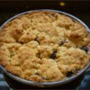 Blueberry 'S' Pie Recipe - A quick oat streusel sandwiches a filling of sweet blueberries in this easy dessert.