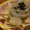 Hot Mexican Spinach Dip Recipe - Take your taste buds on a wild joyride to old Mexico with this hot, creamy dip. Spinach, salsa and Monterey Jack cheese are blended in a harmonious flamenco of flavors that's great with tortilla chips.