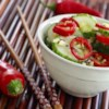 Asian Cucumber Salad Recipe - Sliced cucumbers and red chile peppers are tossed with a rice vinegar and sesame oil dressing.