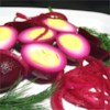 Pennsylvania Dutch Pickled Beets and Eggs Recipe - Allow two days for the hard boiled eggs, chopped onion and canned beets to marinate in a cooked brine of  vinegar, sugar, bay leaf and cloves.