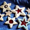 Raspberry Star Cookies Recipe - A delicious cookie filled with raspberry jam and topped with an almond flavored glaze.