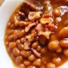 Baked Beans II Recipe - What a great way to wake up pork and beans. Add a little sweet, a little spice, and a little onion, and then bake it with bacon over the top.