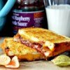 Roasted Raspberry Chipotle Grilled Cheese Sandwich on Sourdough Recipe - Smoky and sweet with a hint of heat, here's a twist on a classic grilled cheese sandwich with roasted raspberry chipotle sauce.