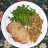 Rosemary Sherry Pork Chops Recipe - Rich, fragrant and delicious, these pork chops are dredged in well-seasoned flour, browned, and then braised in a full-flavored sauce.