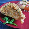My Mom's Parmesan Chicken Recipe and Video - Parmesan-crusted chicken bathes in butter and white wine for an elegant touch to a family favorite.
