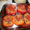 Fiesta Stuffed Peppers Recipe - I don't really care for stuffed green peppers, but I have found that I really like them with yellow, orange, or red peppers. The salsa gives these an added kick.