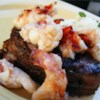 Lobster Colorado Recipe - Bacon-wrapped filet mignons are broiled and topped with lobster meat for a very special dinner. Elegant for dinner parties or a romantic dinner for two. If you desire crabmeat instead of lobster, go for it!