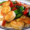 Sesame Shrimp Stir-Fry Recipe - This quick and tasty main dish has a double hit of sesame oil and seeds that add nutty flavor to crisp peppers and shrimp.