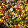 Okra, Corn and Tomatoes Recipe - Okra and onions are fried with bacon, then simmered with canned tomatoes and corn in this delicious side dish that is especially good served with cornbread. Fresh or frozen vegetables can be used.