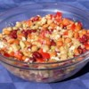 Bob's Bean Salad Recipe - A super tasty bean salad that can almost double as a main course. A three bean medley of red kidney, pinto, and garbanzo beans, tossed with red bell pepper, marinated artichoke hearts, and feta cheese. Served chilled after marinating for only an hour in a zesty oil and vinegar dressing.