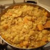 Curried Squash, Garbanzo Bean, and Potato Stew Recipe - Curry powder and crushed red pepper add a dose of spice to this thick garbanzo bean, potato, cauliflower, and squash stew.