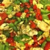 Scrambled Tofu Recipe and Video - Tomatoes, green onion, and Cheddar cheese make this protein-packed tofu scramble a tasty breakfast. You're family won't miss the eggs!