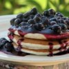 Citrus Wild Blueberry Sauce Recipe - Made with wild blueberries, this sauce adds a zing with lemon juice, orange juice, and lemon zest. Serve over waffles or pancakes.