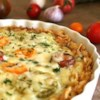 Sweet Onion Pie Recipe - This delicious pie has a buttery cracker crumb crust and is stuffed with sweet onions. It is superb along side any barbequed meat -- especially pork.