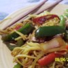 Vegetable Lo Mein Recipe - Whip up a zesty blend of hoisin sauce, honey, soy, ginger, cayenne and curry powder to flavor this fabulous stir fry of mushrooms, carrots, peppers, onion, garlic, bean sprouts and green onion. Toss with hot spaghetti.