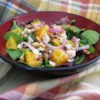 Orange, Walnut, Gorgonzola and Mixed Greens Salad with Fresh Citrus Vinaigrette Recipe - This summery salad is made with salad greens, fresh oranges, red onions, glazed walnuts, and Gorgonzola cheese, then topped with a homemade citrus vinaigrette.