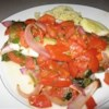 Baked Trout Saratoga Recipe - A simple preparation with extraordinary results - trout baked with tomatoes, parsley, and garlic is prepared in minutes.