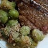 Mom's Brussels Sprouts Recipe - Brussels sprouts are topped with a buttery brown sugar sauce and walnuts.