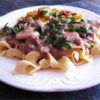 Easy Beef Stroganoff Recipe and Video - A lusciously tart sauce of sauteed mushrooms, onions and sour cream is beefed up and served over tender egg noodles. Hint: do not bring the sour cream sauce to a boil.