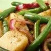 Warm Green Bean and Potato Salad with Goat Cheese Recipe - A delicious salad of green beans, potatoes, red peppers, and goat cheese goes perfectly with chicken or pork. Experiment with other potato types such as purple and other soft cheeses, such as garlic and herb.